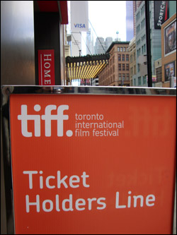 TIFF sign, lining up for Page Eight. Front of the line, September 17th
