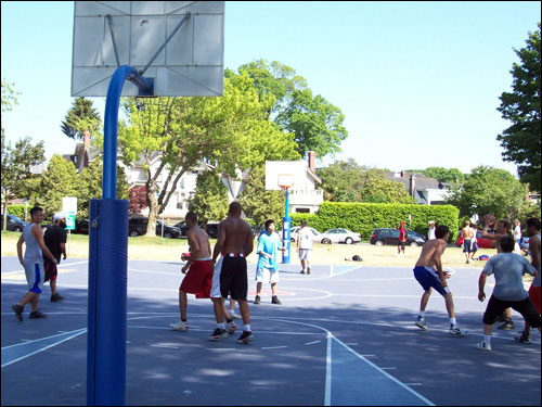 Basketball game, court across from Kits Beach