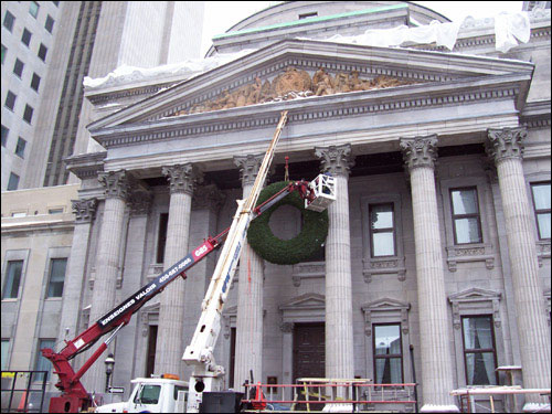 Christmas wreath going up, old Montreal